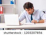 overloaded busy employee with...   Shutterstock . vector #1203207856