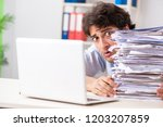 overloaded busy employee with...   Shutterstock . vector #1203207859