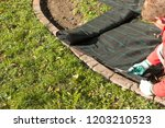 lay garden fleece | Shutterstock . vector #1203210523