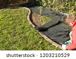 lay garden fleece | Shutterstock . vector #1203210529