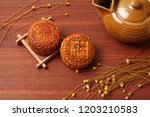 mooncakes on table | Shutterstock . vector #1203210583