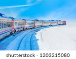 trail of white smoke from the... | Shutterstock . vector #1203215080
