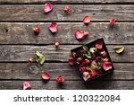 Stock photo many rose petals inside open gift box and scattered on old vintage wooden plates sweet holiday 120322084