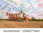 the oil pump  the dollar and... | Shutterstock . vector #1203277663