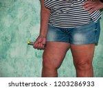 an allergic woman injecting an... | Shutterstock . vector #1203286933