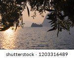 profile of little island in the ...   Shutterstock . vector #1203316489