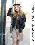 young beautiful woman walks... | Shutterstock . vector #1203398680