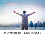 travel man happy and raise hand ... | Shutterstock . vector #1203404653