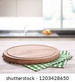 kitchen towel on wooden table... | Shutterstock . vector #1203428650