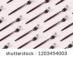 pattern made of cutlery on... | Shutterstock . vector #1203454003