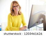 portrait of attractive smiling... | Shutterstock . vector #1203461626