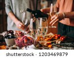 pouring champagne at a dinner... | Shutterstock . vector #1203469879