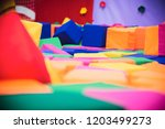 multicolored soft rag cubes in... | Shutterstock . vector #1203499273
