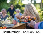 in the summer  a family of... | Shutterstock . vector #1203509266