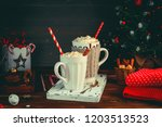 cozy christmas composition.two... | Shutterstock . vector #1203513523