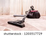 vacuum cleaner in the room on... | Shutterstock . vector #1203517729
