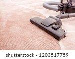 vacuum cleaner in the room on... | Shutterstock . vector #1203517759