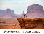 cowboy looking at the horizon ... | Shutterstock . vector #1203523039
