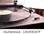 turntable vinyl record player... | Shutterstock . vector #1203552679