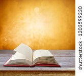 open book on table in front of... | Shutterstock . vector #1203599230