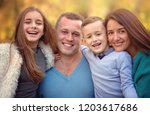 autumn portrait of happy family ... | Shutterstock . vector #1203617686