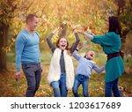 autumn portrait of happy family ... | Shutterstock . vector #1203617689