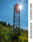 Small photo of Northport, Michigan / USA 10 09 2018: Automatic light tower that is still in use as an aid to navigation at Grand Traverse Lighthouse, Leelanau Peninsula, Michigan, USA.