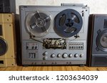 old reel to reel recorder with... | Shutterstock . vector #1203634039