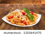 a baked dish of fusilli or...   Shutterstock . vector #1203641470