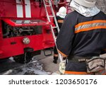 fireman extinguishes the fire...   Shutterstock . vector #1203650176