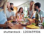 group of friends having great... | Shutterstock . vector #1203659506