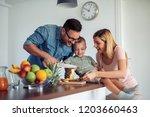 cheerful family making fruit... | Shutterstock . vector #1203660463