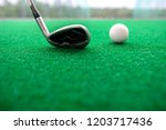 golf club and balls on a...   Shutterstock . vector #1203717436