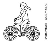 young woman riding bicycle...   Shutterstock .eps vector #1203745873