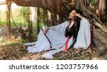beautiful chinese woman with a...   Shutterstock . vector #1203757966