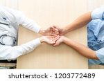 close up of empty hands holding ... | Shutterstock . vector #1203772489