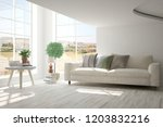 white room with sofa and autumn ... | Shutterstock . vector #1203832216