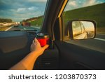 hand taking cup from cup holder ... | Shutterstock . vector #1203870373