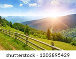 bright dawn in mountains. view... | Shutterstock . vector #1203895429