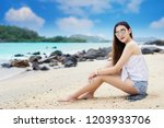 asian woman relaxing on the... | Shutterstock . vector #1203933706