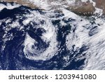 typhoon from space. satellite... | Shutterstock . vector #1203941080