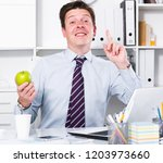 young and smiling man talking...   Shutterstock . vector #1203973660