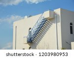 steps on flat rooftop outdoors. ... | Shutterstock . vector #1203980953