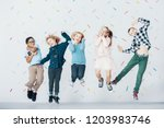 smiling multicultural group of... | Shutterstock . vector #1203983746