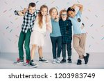 happy multicultural group of... | Shutterstock . vector #1203983749