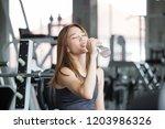 fitness  asian woman in...   Shutterstock . vector #1203986326