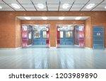 school corridor interior exit.... | Shutterstock . vector #1203989890