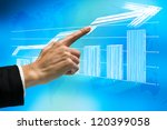 Female business hand pointing on graphic sketch in virtual interface. - stock photo