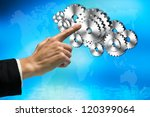 Female business hand pointing at metallic gear icons in futuristic interface. - stock photo