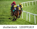 Stock photo jockey and race horse taking the lead in a race 1203991819